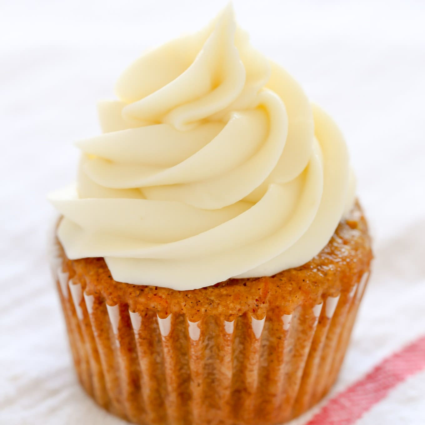 An easy recipe for cream cheese frosting made with four simple ingredients and ready in just a few minutes. This frosting pipes perfectly and can be used on so many different desserts!