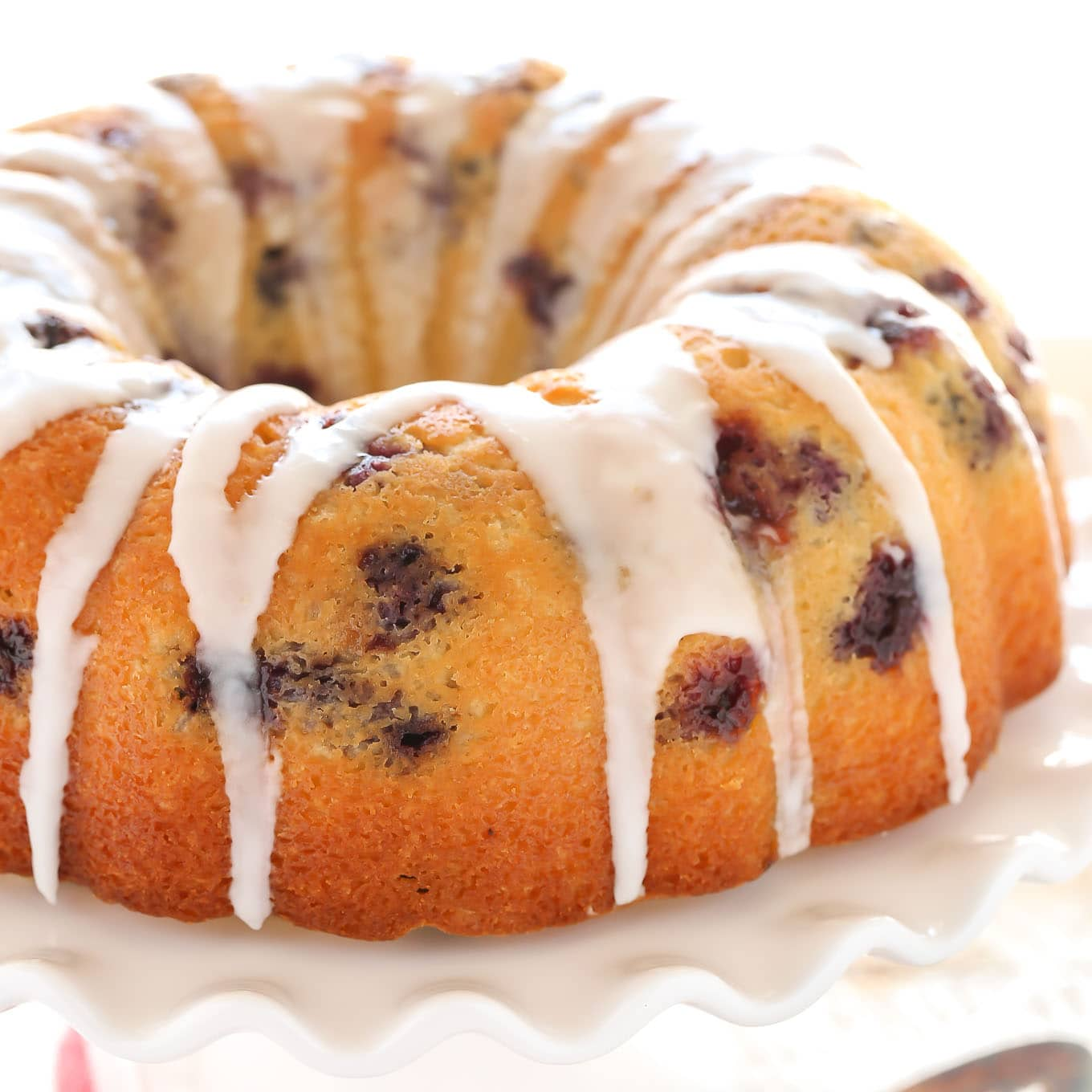 A moist lemon bundt cake filled with fresh blueberries and topped with a sweet lemon glaze. This Lemon Blueberry Bundt Cake is a perfect dessert for lemon lovers!