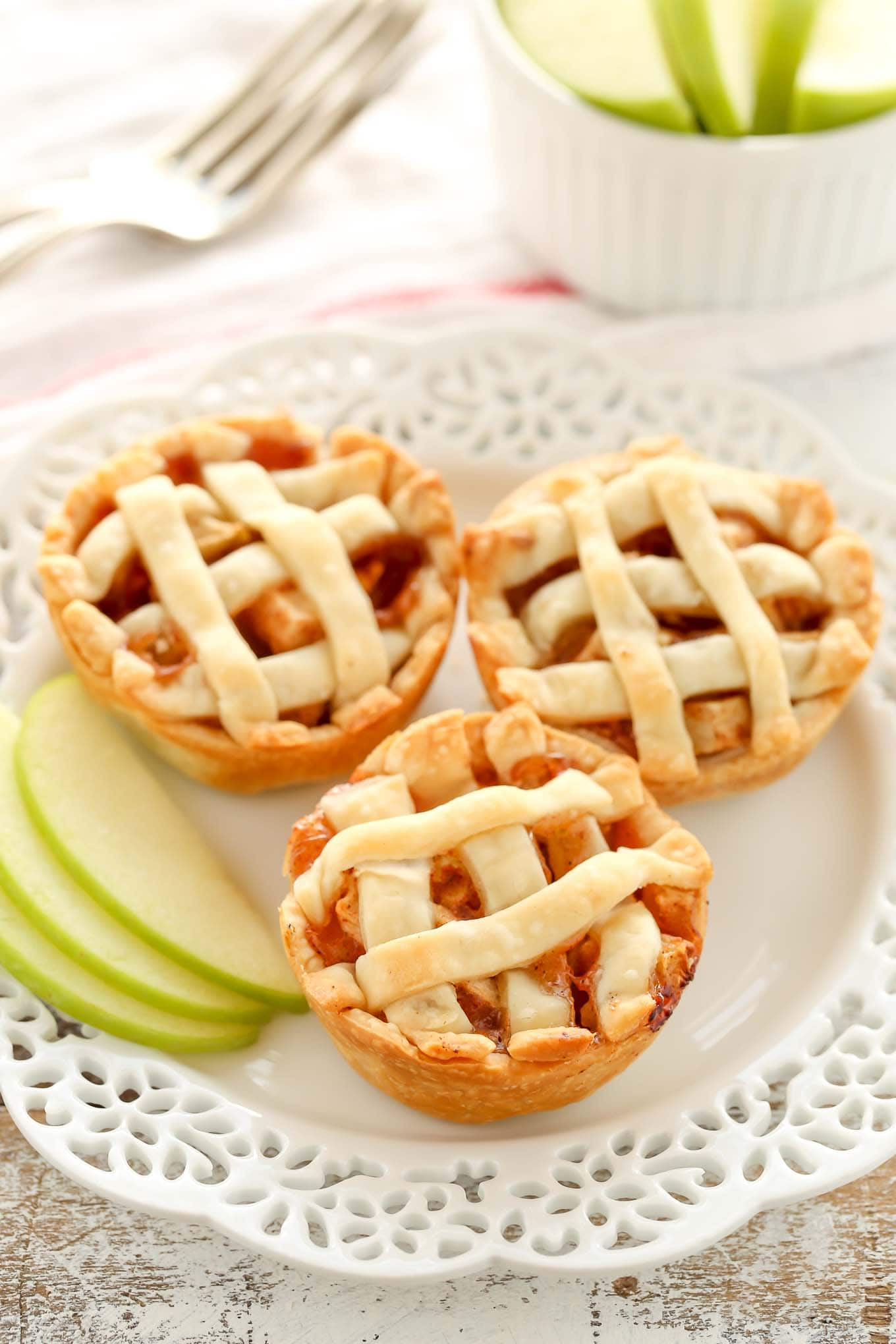 These Mini Apple Pies are easy to make and filled with a simple homemade apple pie filling. The perfect mini dessert for fall!