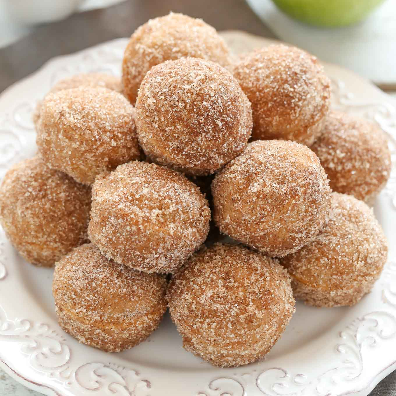 An easy recipe for Baked Apple Cider Donut Holes coated in either cinnamon and sugar or an apple cider glaze. Plus instructions for how to make Baked Apple Cider Donuts too!