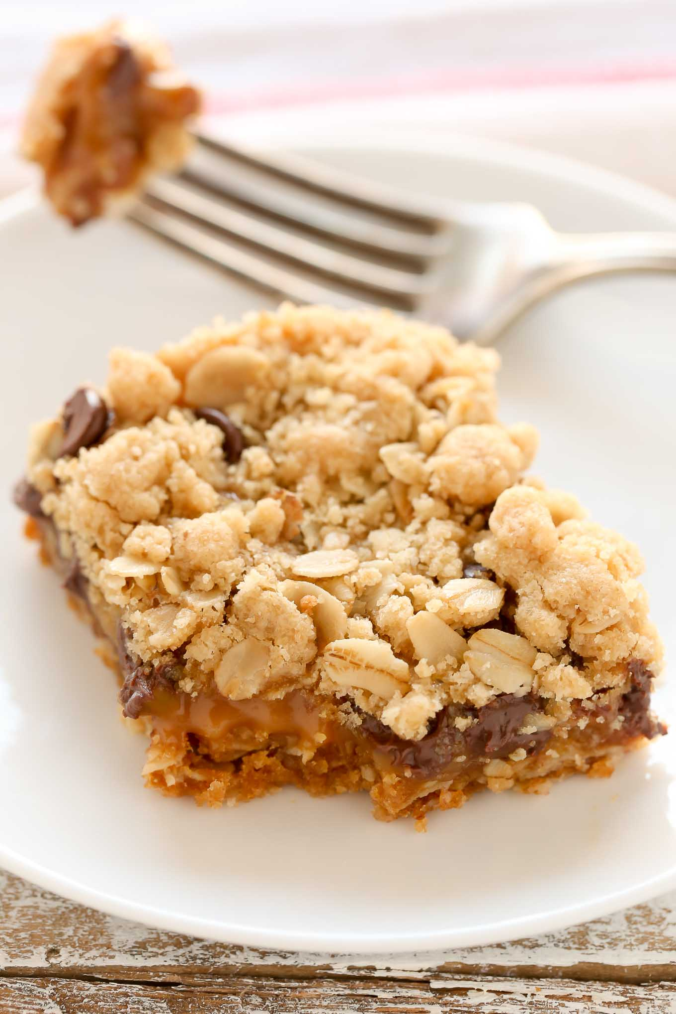 Soft oatmeal crumb bars stuffed with gooey caramel, chocolate chips, and chopped pecans. These Carmelitasuse the same mixture for the crust and topping and are so easy to make!