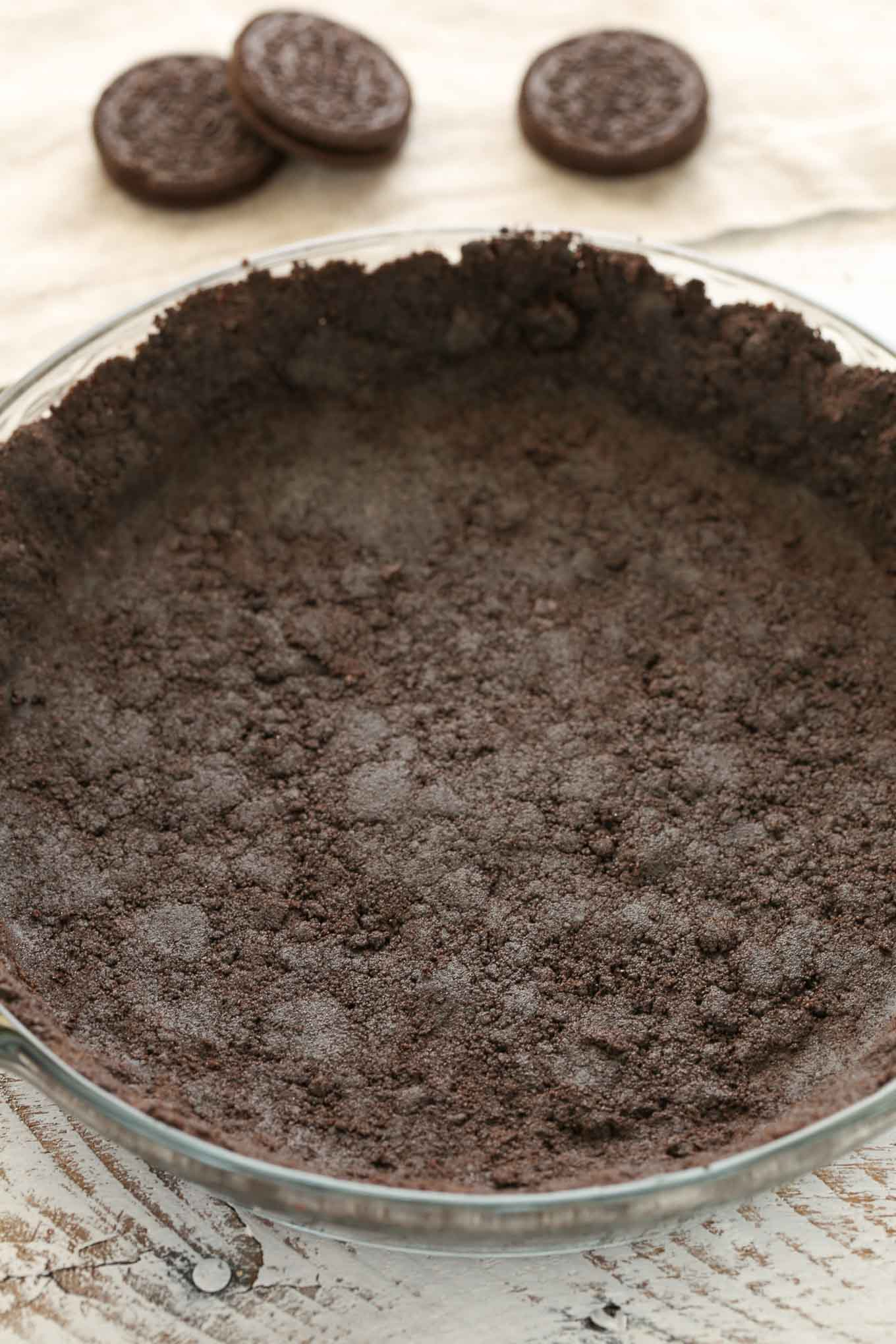 Learn how to make your own homemade Oreo pie crust with just two ingredients in less than 10 minutes. Perfect for baked or no-bake pies!