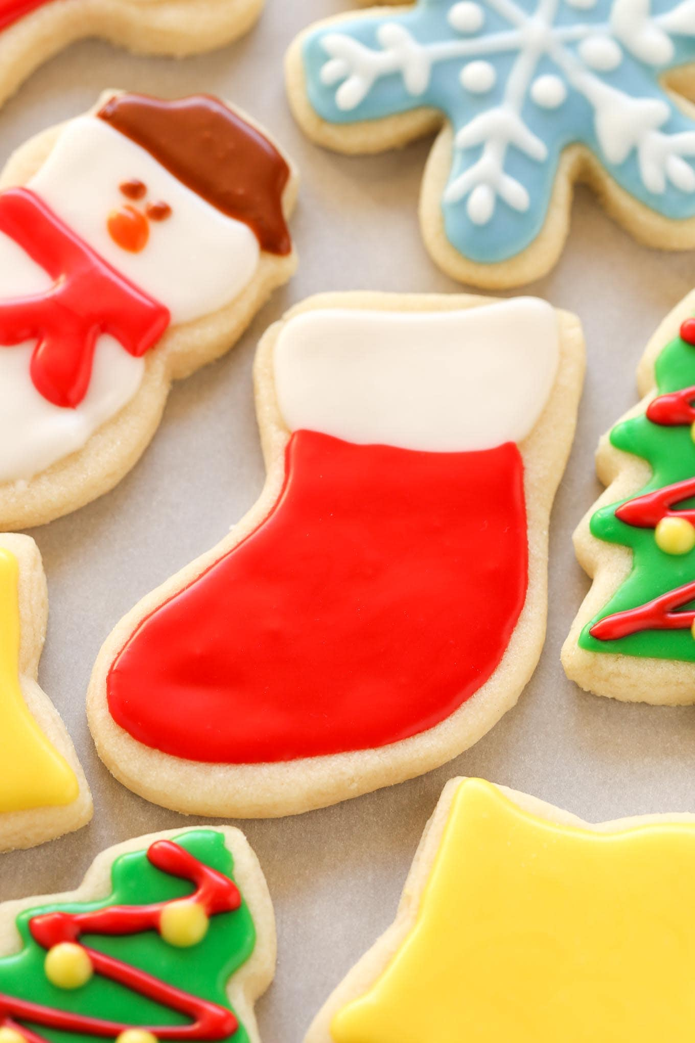 Super soft cut-out sugar cookies decorated with an easy icing. These Christmas Cut-Out Sugar Cookies are so fun to decorate and perfect for the holidays!