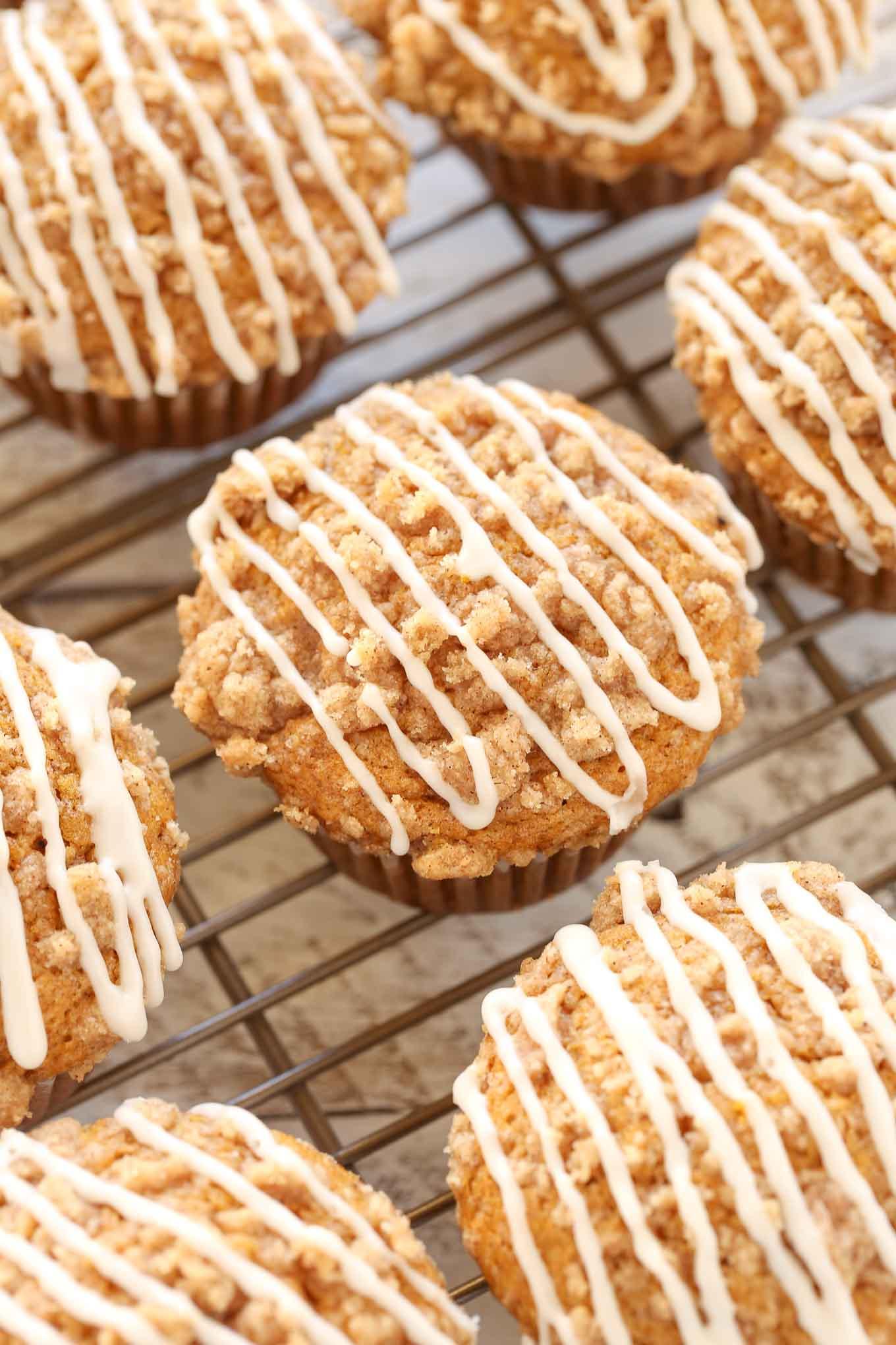 Glazed pumpkin muffins on a cooling rack.