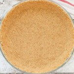 Learn how easy it is to make your own graham cracker crust with this simple tutorial! You only need three ingredients and about 10 minutes to prepare this pie crust. This recipe also works great for baked or no-bake pies!