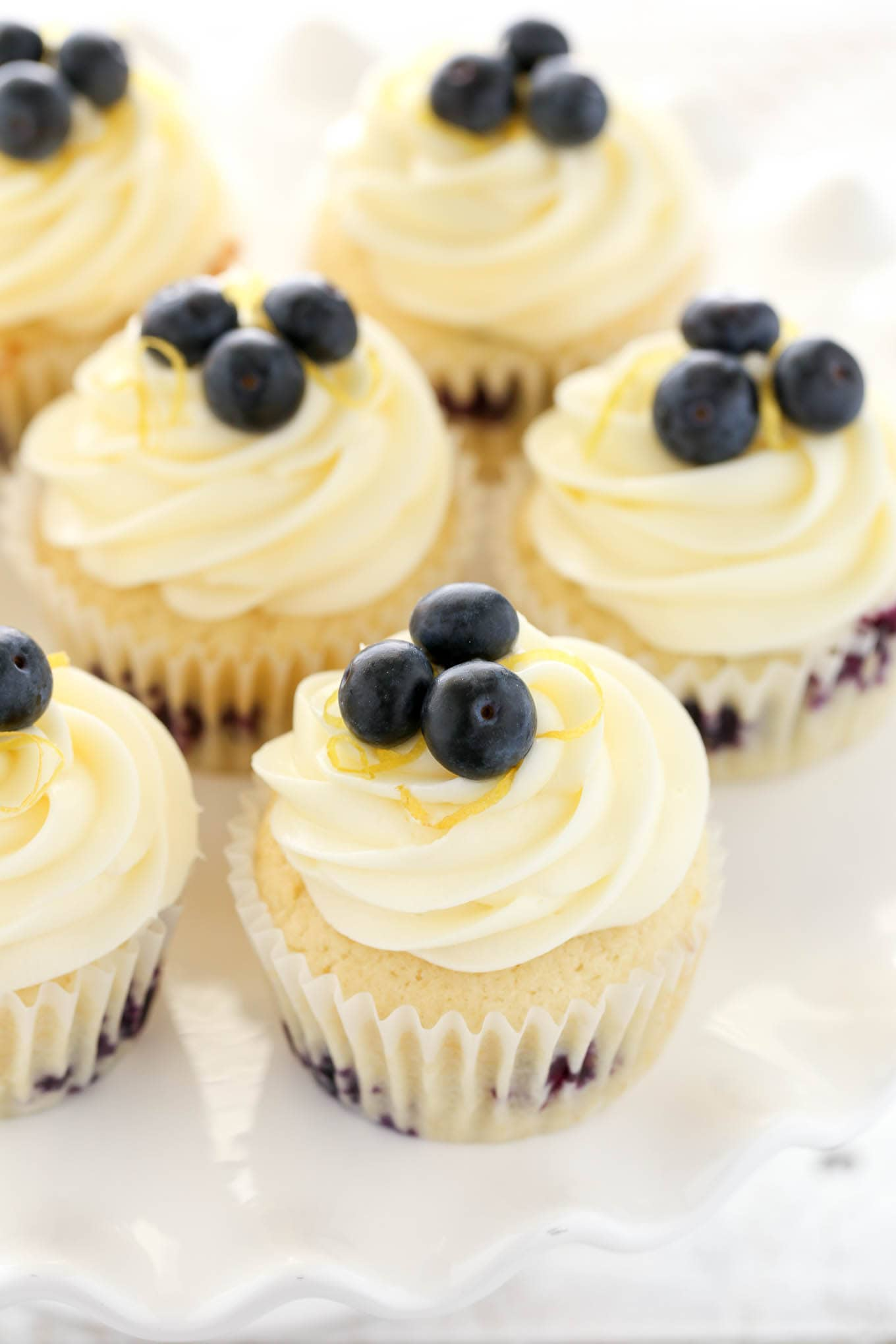 Soft, light, and moist lemon cupcakes loaded with fresh blueberries and topped with an easy lemon cream cheese frosting. These Lemon Blueberry Cupcakes are the perfect dessert for spring or summer!