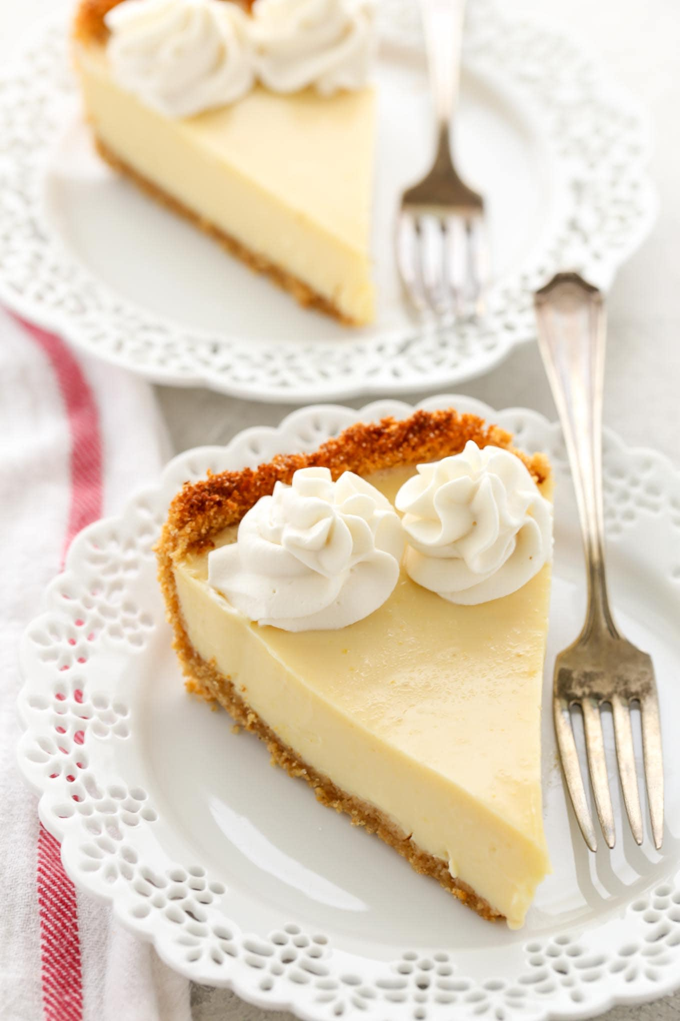 This easy Lemon Pie features a homemade graham cracker crust, a creamy lemon filling, and homemade whipped cream on top. The perfect dessert for lemon lovers!