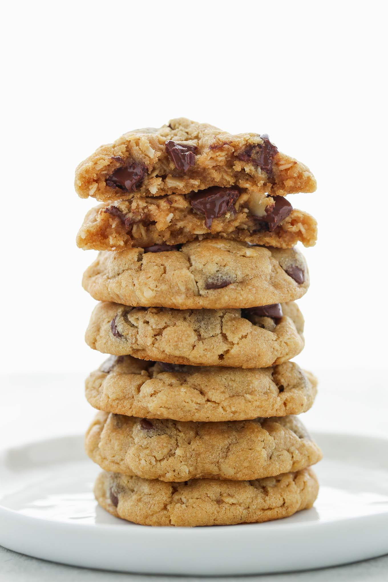 A stack of Peanut Butter Oatmeal Chocolate Chip Cookies on a white plate.