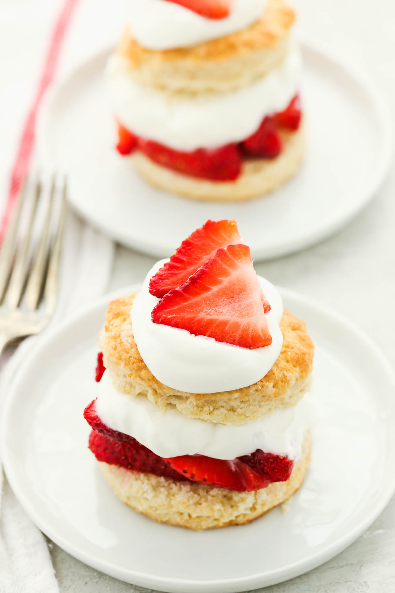 Lightly sweetened biscuits topped with sweet, juicy strawberries and homemade whipped cream. This Homemade Strawberry Shortcake is easy to make from scratch and so delicious!