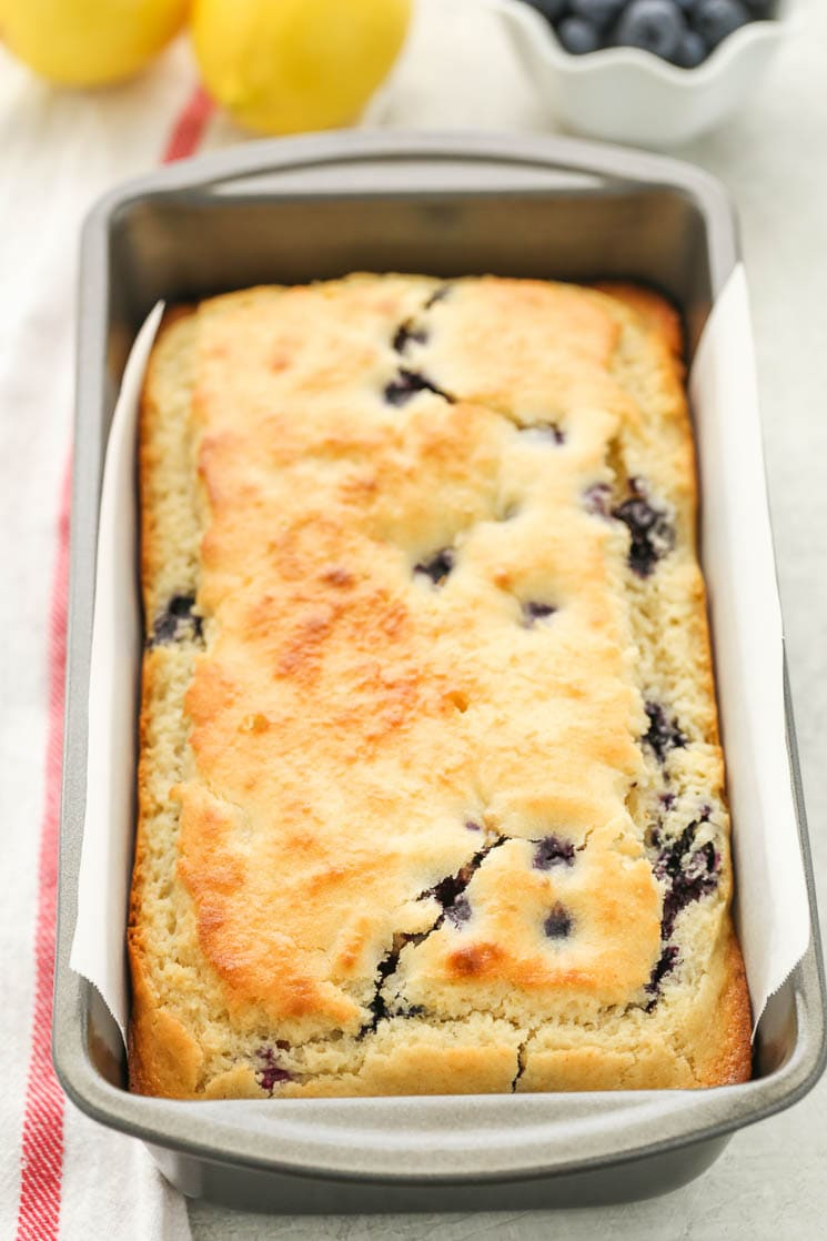 This Blueberry Lemon Bread is super moist, easy to make, and topped with a delicious lemon glaze. Perfect for breakfast or dessert!