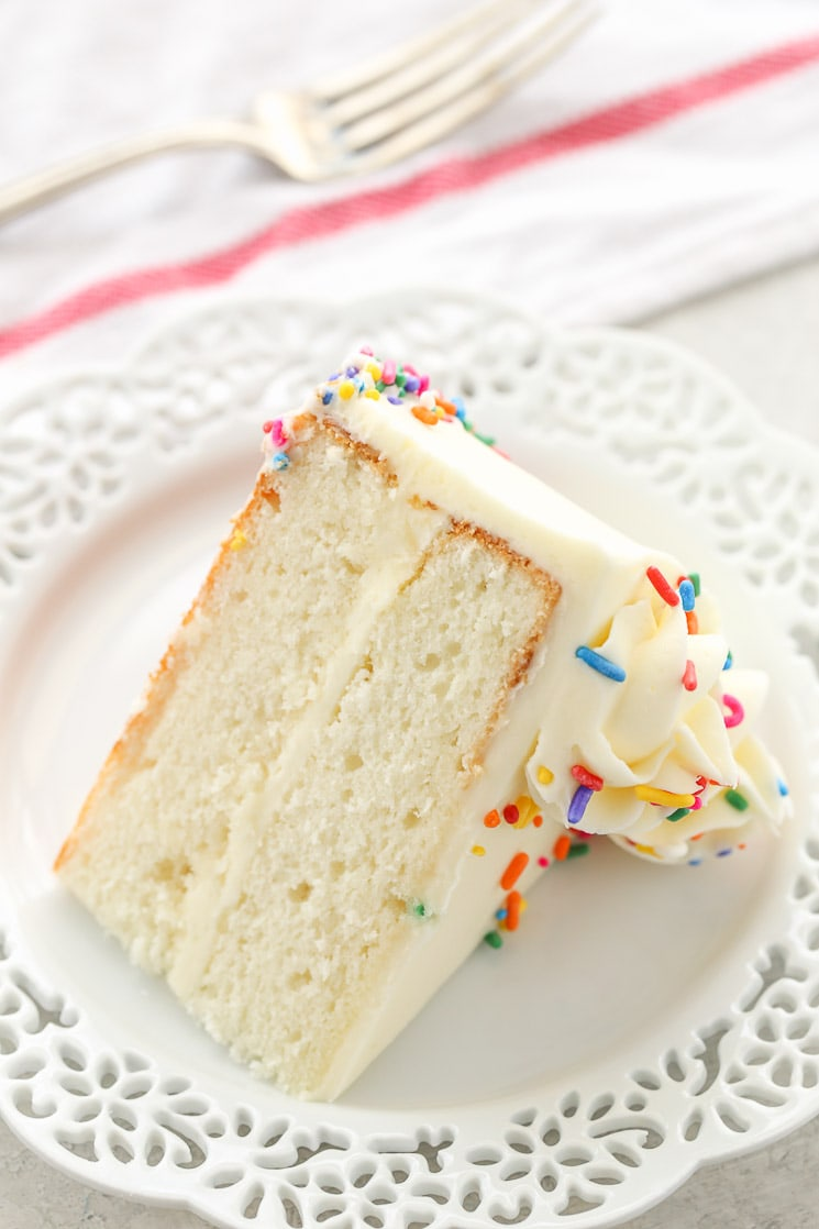 This is my favorite white cake recipe! This cake is light, tender, moist, and topped with a delicious vanilla buttercream frosting.
