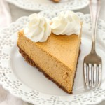 A smooth and creamy pumpkin cheesecake with an easy homemade gingersnap cookie crust. The perfect dessert for fall!