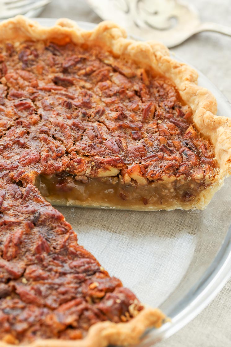 An easy recipe for homemade pecan pie that turns out perfect every time. This classic pecan pie is a family favorite and perfect for the holidays!