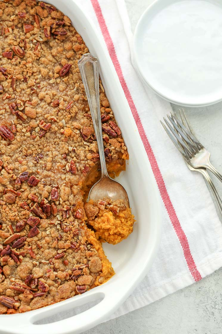 This sweet potato casserole is easy to make and topped with acrunchy pecan streusel. This simple side dish is a family favorite and perfect for Thanksgiving!