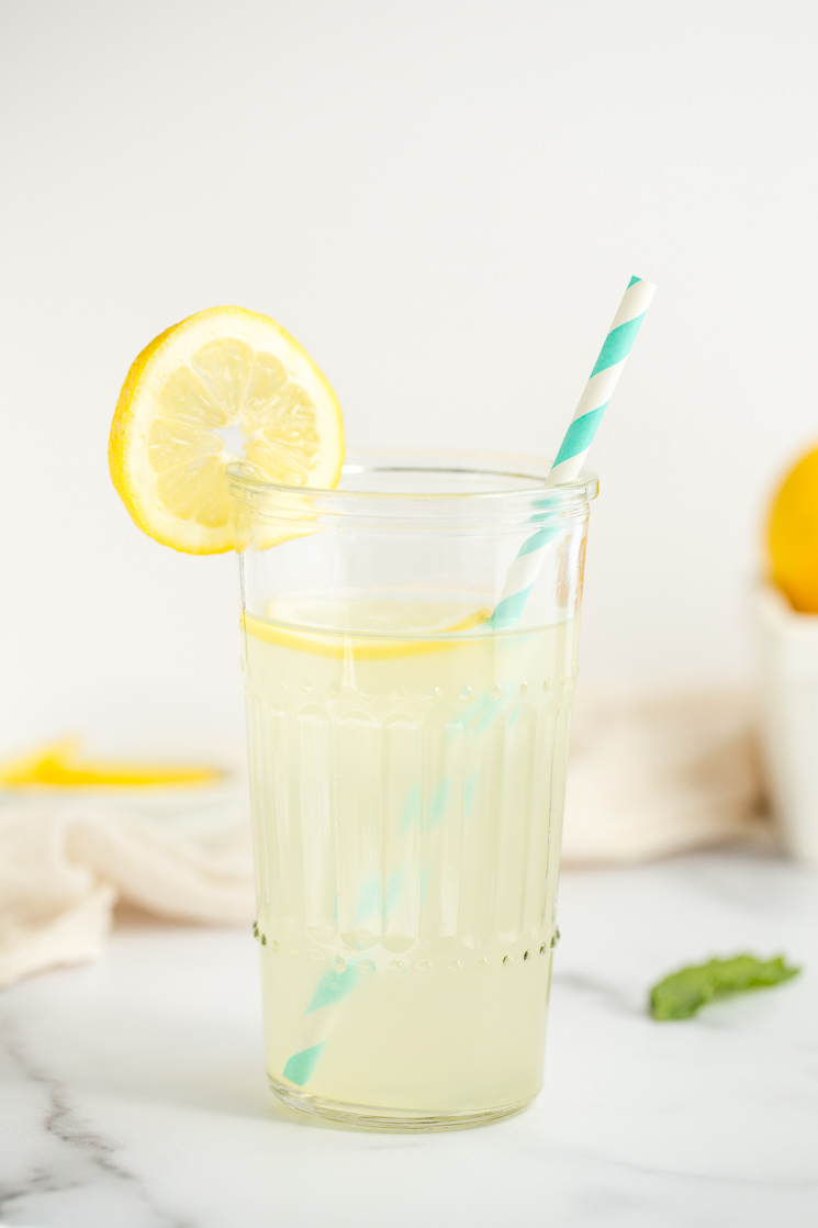 A closeup picture of a glass of lemonade.