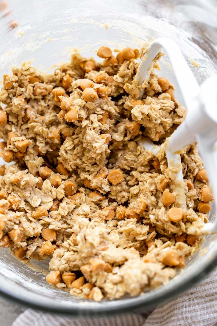 A glass mixing bowl filled with cookie dough.