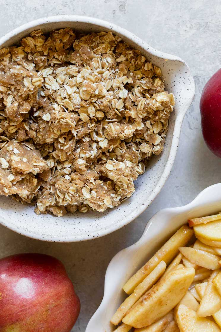 The oat topping mixed together in a small bowl ready to be put on the apples.