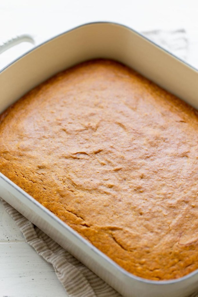 A finished pumpkin cake baked in a 9 by 13 pan.