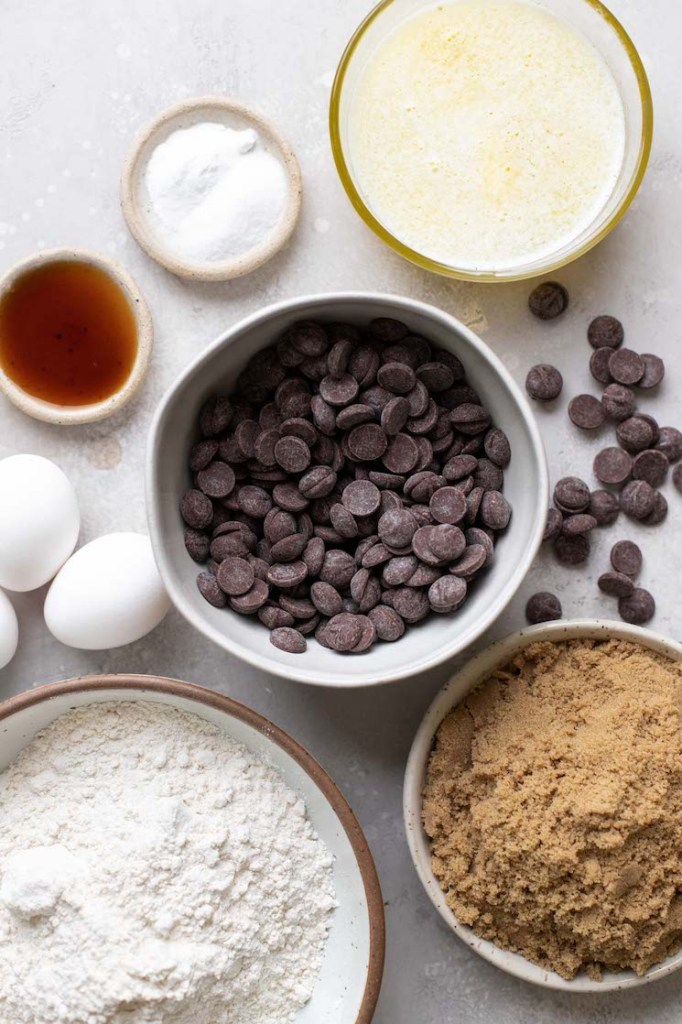 Overhead view of the ingredients needed for chocolate chip bar cookies.