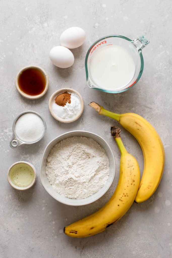 Overhead view of the ingredients needed to make homemade banana pancakes.