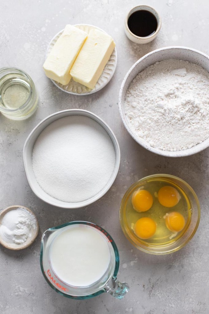 Overhead view of the ingredients needed to make a vanilla cake and vanilla frosting.