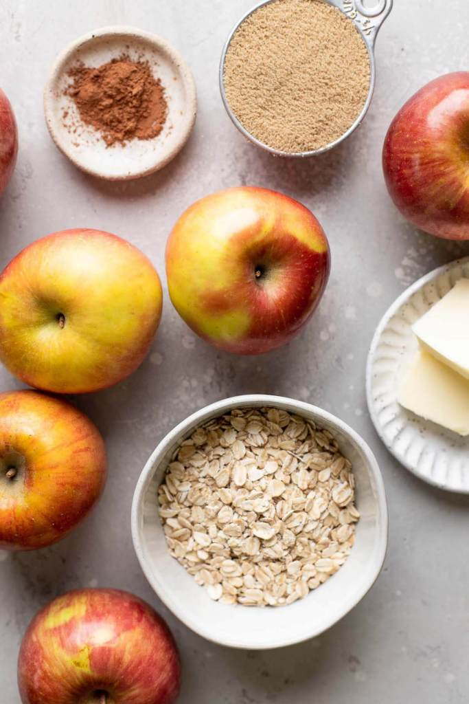 An overhead view of the ingredients needed to make baked apples in the oven.
