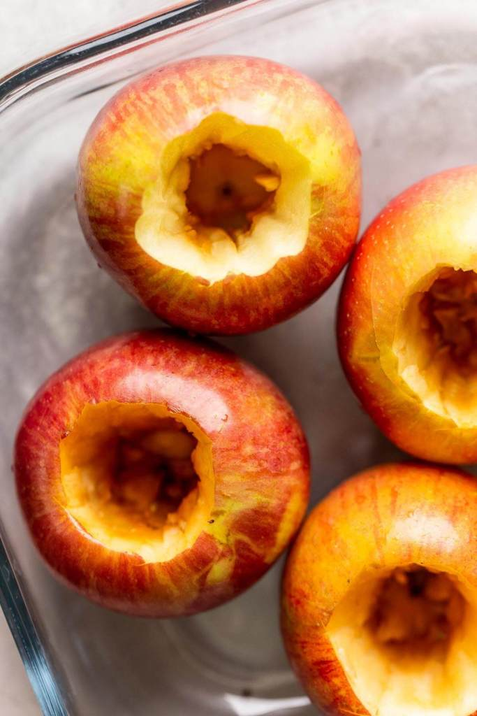 An overhead view of raw apples that have been cored.