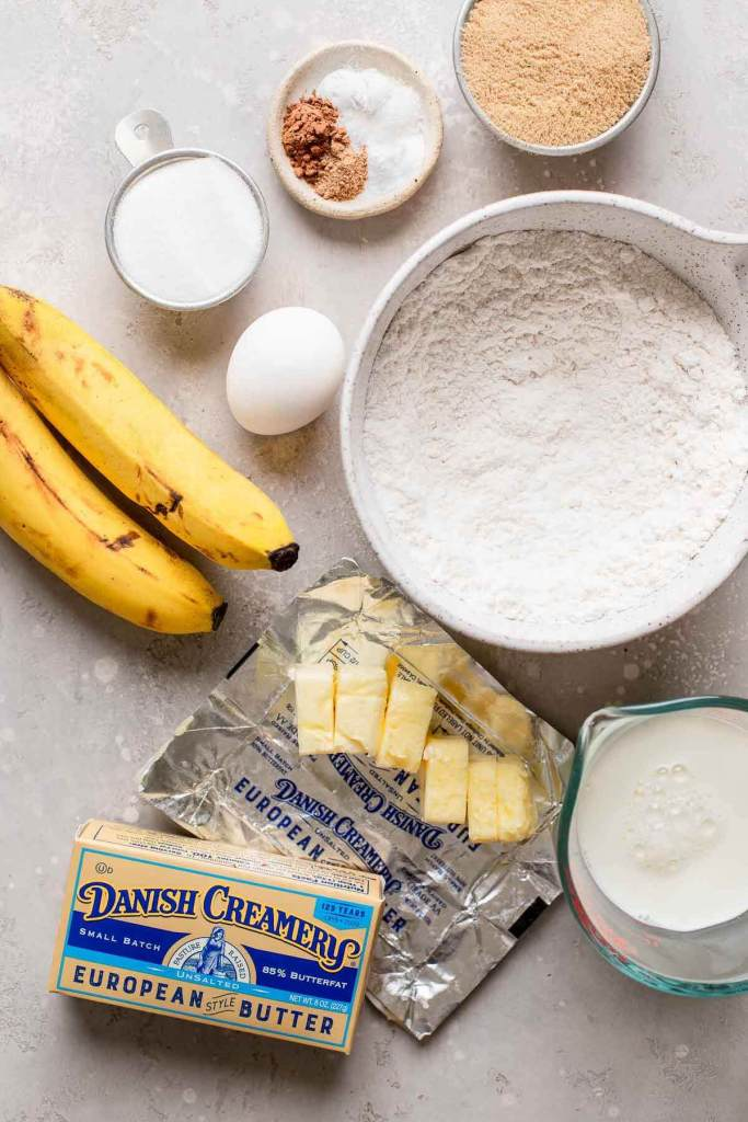 An overhead view of the ingredients needed to make a banana cupcake recipe.