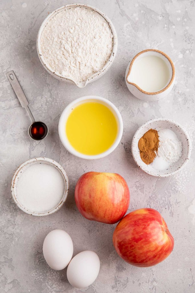 An overhead view of the ingredients needed to make glazed apple fritters.