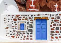 greece-santorini-blue-door-red-beach