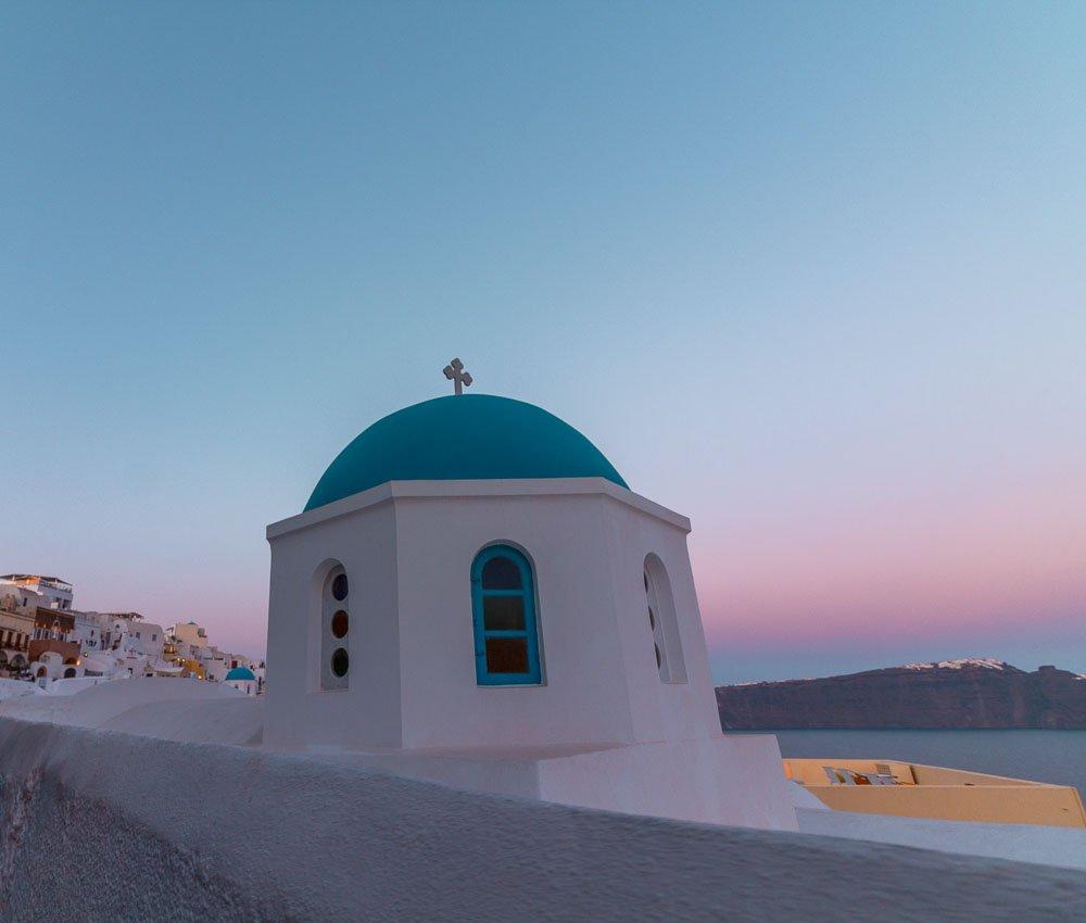 santorini-oia-sunset-blue-domed-church