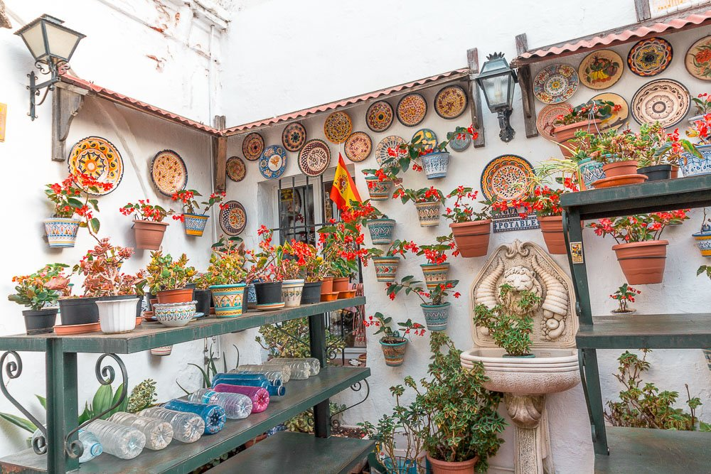 Colorful flowers surrounding the shops in Mijas