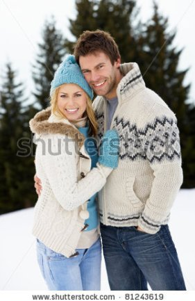 stock-photo-young-couple-in-alpine-snow-scene-81243619
