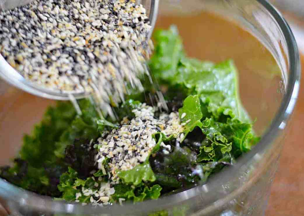 Add Everything Bagel Seasoning to massaged kale coated with oil