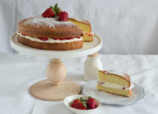Genovese sponge cake filled with strawberries and cream