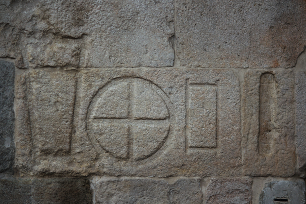 Historic measurements carved into the stone wall in Piazza Erbe (the different shapes were used for textiles, meals, bricks and cereals and seeds)