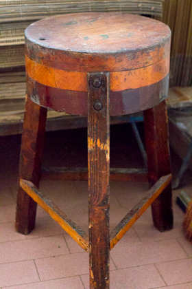 The stool they place the wheels of cheese to test them
