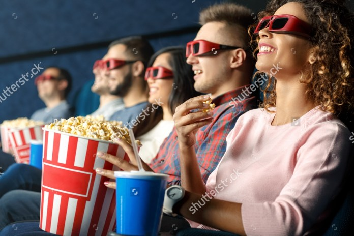 stock-photo-seeing-it-in-d-friends-sitting-and-eating-popcorn-together-while-watching-movies-at-the-cinema-342826676