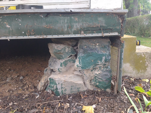 sinking front porch