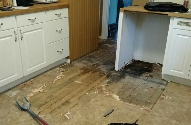 aftermath of dishwasher leak on kitchen floors