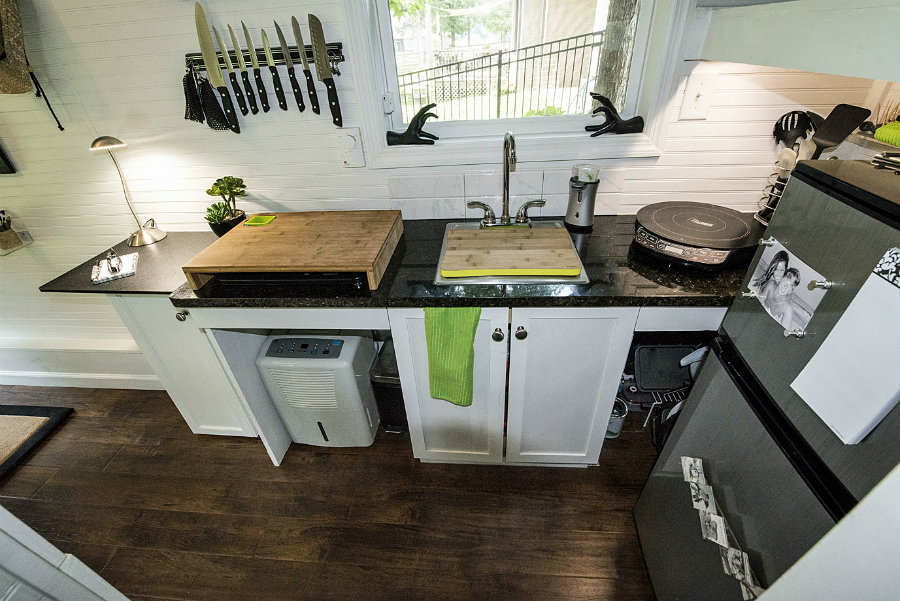Attractive You Find This Small But Efficient Kitchen In Mendyu0027s Tiny House That Was  Designed And Build By Tennessee Tiny Homes. The All White Interior Makes  The ...