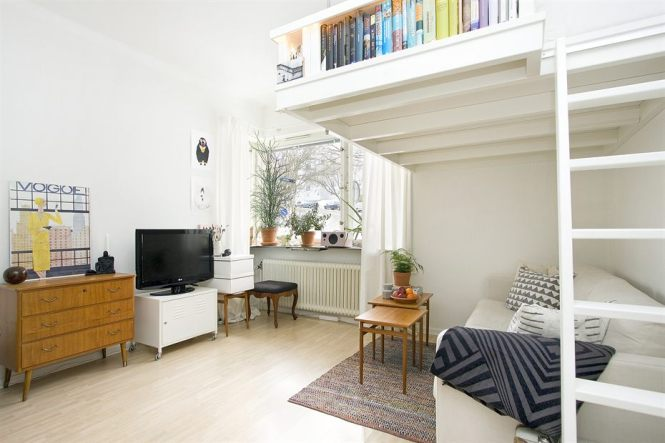 Small Swedish Studio Apartment Elegantly Combines Loft Bed And Book Shelves