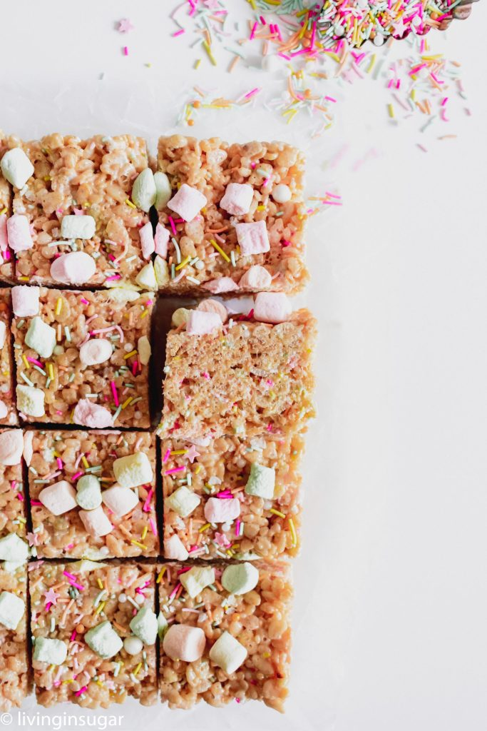 Easter Rice Krispie treats lined up on parchment paper