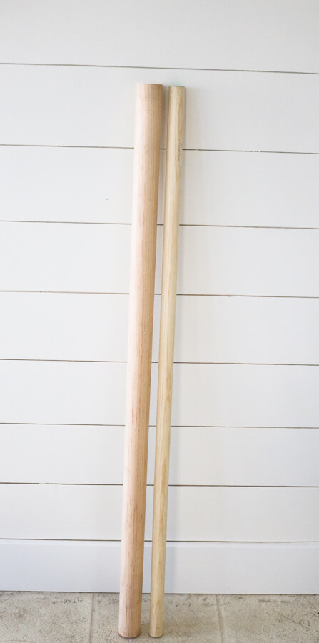 wooden dowel rods against a shiplap wall