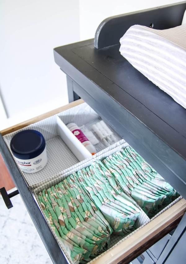 organized nursery dresser with diapers