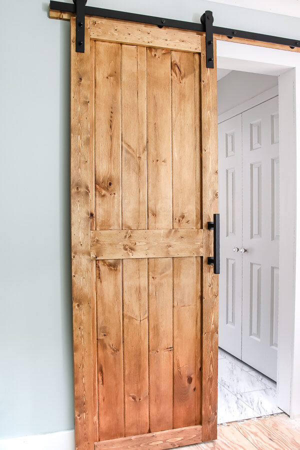 DIY sliding barn door hanging up
