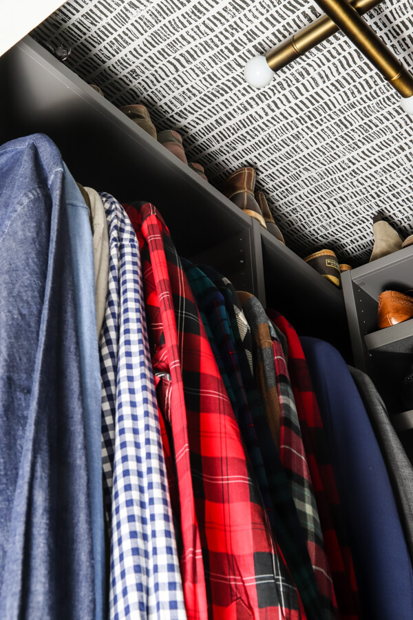 men's shirts hanging in gray Ikea AURDAL closet shelving unit