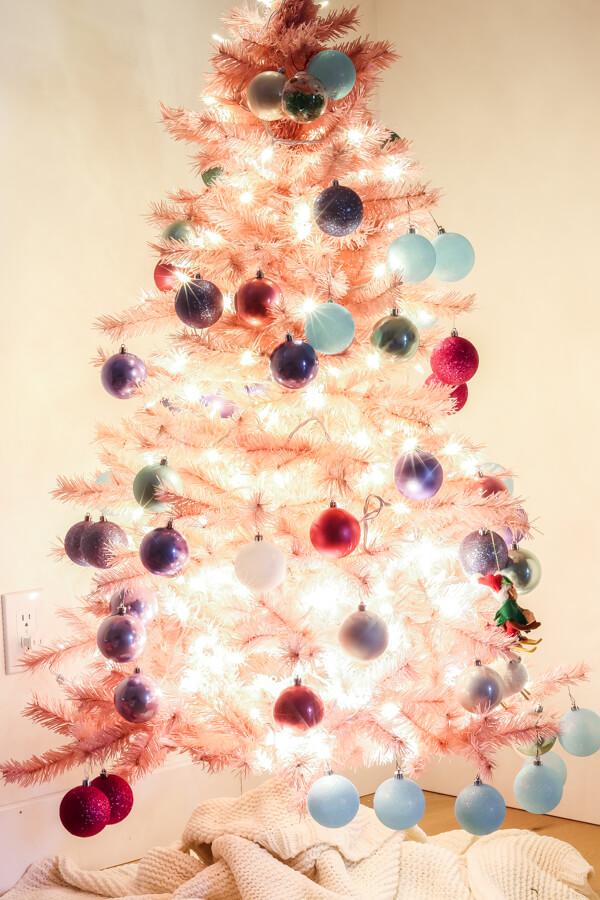 Pink Christmas tree with lights on