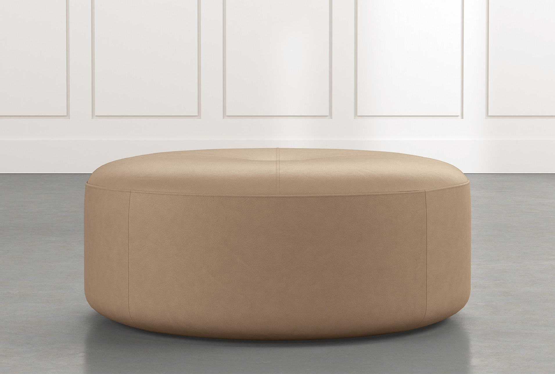 light brown round leather ottoman