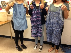 Students displaying dresses they made